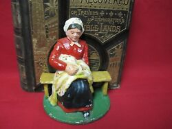 Antique Cast Iron Amish Woman Bookend Doorstop Seated On A Bench