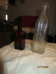 Two Vintage Bottles, 1clear Liquor And 1 Amber Shuco Shampoo