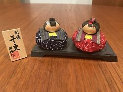 Vintage Rice Bag Kokeshi Dolls Wood And Cloth Paper Features On Platform And Sign