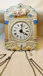 Antique Wood Cased Wall Clock With Chime And A Decorative Porcelain Front