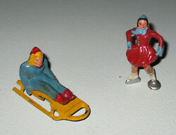 Barclay 1950s-1960s Metal Sled Rider With Lady Skating