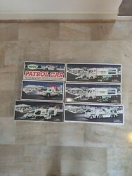 Six Unopened Hess Trucks 2001,1994, 2006,1993 And Two 2003