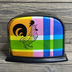 Vintage Toy Metal Tin Toaster Rooster On Pastel Plaid Background