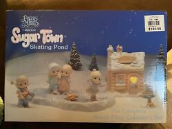 Precious Moments Sugar Town Skating Pond 7 Piece Christmas Collector Set Retired