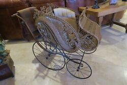 Brown Wicker Baby Carriage With Iron Wheels