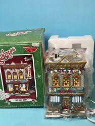 Department 56 - A Christmas Story Village Lighted Building - The Joke Shop New