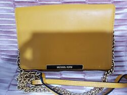 Michael Kors Wallet Clutch Color BUTTER with gold shoulder chain READ $32.88
