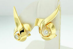 TIFFANY & CO. PALOMA PICASSO RIBBON 18 K YELLOW GOLD EARRINGS WITH ROUND DIAMOND