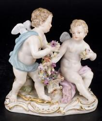 Decor Art. Germany. Meissen Sculpture. Two cupids with a garland of flowers.