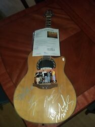 Motley Crue Autographed guitar. signed by all 4 members.