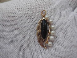 Vintage 14k Hawaiian Black Coral Coral Pendant With Pearl Accent.