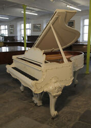 A 1979 Louis XV style Steinway Model O grand piano with gilt detail