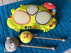 B. Toys Ribbit-tat-tat Electronic Light-up Musical Frog Drum Toy With Drumsticks