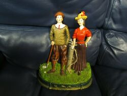 Cast Iron Painted Golfer Man And Woman
