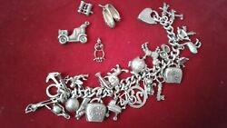 Vintage Solid Sterling Silver Charm Bracelet 29 Charms. Chunky 76.8 Grams