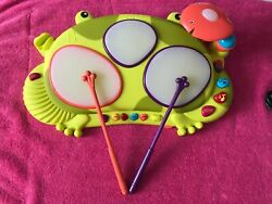 B. Toys Ribbit-tat-tat Electronic Light Up Musical Frog Drum Toy With Drumsticks