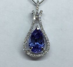 18 Carat White Gold 11x8mm Pear Cut Tanzanite And Diamond Pendant And Chain.