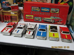 6 Assorted Tin Litho Cars In Display Box 50s Friction Taxi, Limo, Police Etc