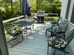 slightly used Cast Iron Outdoor Furniture, Table And Four Chairs. Green.