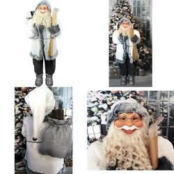 5 Ft. Christmas Standing Santa Claus Holding Skis And Wearing A Furry White Jack