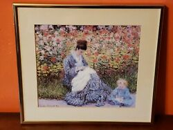 Camille Monet And A Child In The Garden Painting Framed Print By Claude Monet