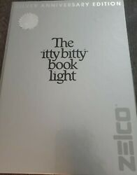 Vintage Zelco 1982 Collector Itty Bitty Book Light Silver Anniversary Edition