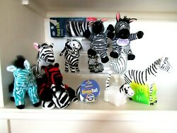 Lot 14 ZEBRA COLLECTIBLES. Fuzzy DICE 3 small figurines bank beanies .