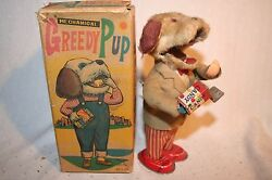 greedy pup tin wind up over plush box 1960