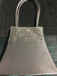 Silver evening bag with handles Unique shape with star design $8.00