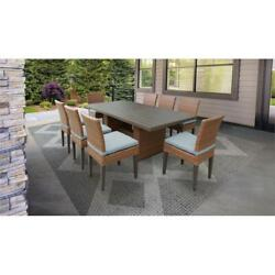 Laguna Rectangular Outdoor Patio Dining Table With 8 Armless Chairs In Spa