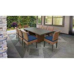 Laguna Rectangular Outdoor Patio Dining Table With 8 Armless Chairs In Navy
