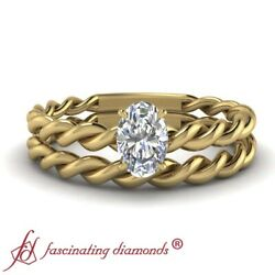 1/2 Carat Oval Shaped Diamond Twisted Rope Solitaire Wedding Sets In Yellow Gold