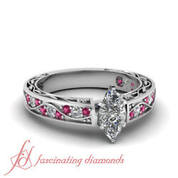 .85 Ct Marquise Cut Diamond And Pink Sapphire Wave Style Pave Set Engagement Ring