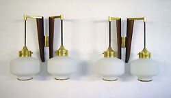 A Pair Of Stilnovo Modernist Wall Lamps In Teak And Brass. Opal Glass. 1950s