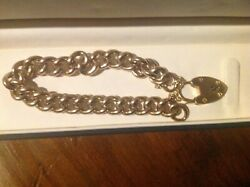 Antique Curb Link Chain Bracelet With A Heart Shaped Padlock Charm