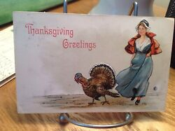 Vintage Thanksgiving Postcard Turkey Next To Woman In Blue Dress And Red Cape