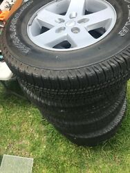 5x Stock Jeep Wrangler Rims And Tires Silver/black