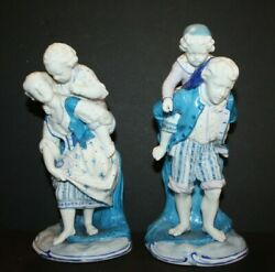 2 Vintage Blue And White Porcelain German Figurines Of Children Being Carried