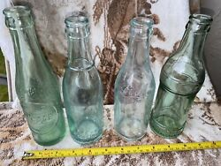 Three Vintage Coca Cola Soda Bottles Rare Mint Condition And One Dr Pepper Look