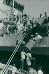 A Cargo Of Oil Drums Being Unloaded - Vintage Photograph 1426119