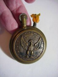Wwi Brass Trench Lighter Round With Embossed Shield Eagle And Cannon And Flag