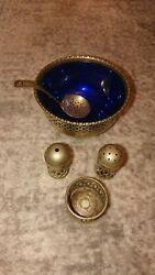 A Collection Of Epns Tableware Salt And Pepper Set Dish With Blue Liner And Spoon.