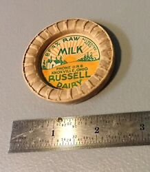 Russell Dairy Raw Milk Bottle Cap. Knoxville Ohio. 1950s.