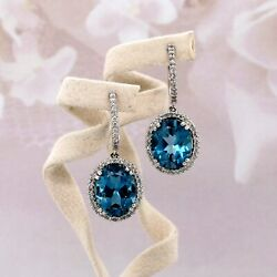 18k White Gold Halo Earrings 6.08 Carats Blue Topaz And .45 Carats Round Diamonds