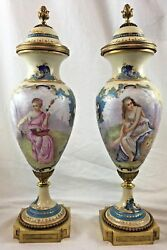 Pair Of 19th Century Sevres Porcelain Urns With Women And Cherubs Signed French