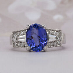 14k White Gold Ring With 2.50 Carats Oval Tanzanite And .54 Carats Round Diamonds