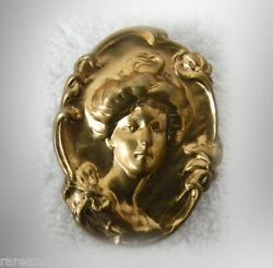 Gold gilt metal brooch with art noveau style - woman portrait