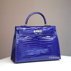 NEW AUTHENTIC HERMES KELLY Bleu Electrique Croc 35cm  with silver hardware