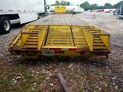 2014 yellow Lone wolf 40 foot gooseneck trailer with ramps. $7000