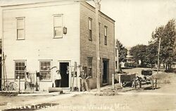 Men In Front Real Photo Smith Trumbo Hardware Store Woodland Michigan Postcard